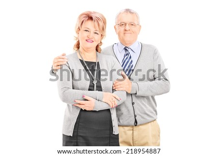 Lovely mature couple posing isolated on white background