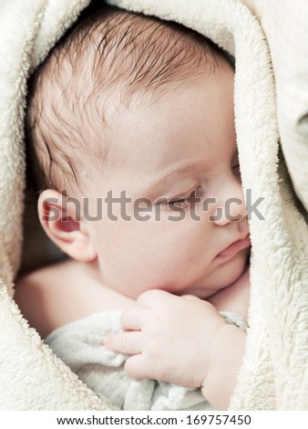 Lovely 3 months baby sleeping in soft blanket, close up face portrait
