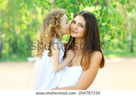 Lovely mother and daughter, happy family - stock photo