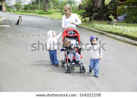Lovely Mother with Her Children, Mums with strollers in the park - stock photo