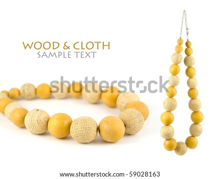 Lovely necklace made from yellow wooden balls and balls made of cloth. Isolated on pure white background. Copy-space. - stock photo