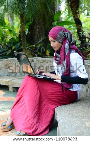 Lovely of young Asian businesswoman take rest with laptop