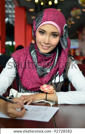Lovely of young Asian businesswoman working - stock photo
