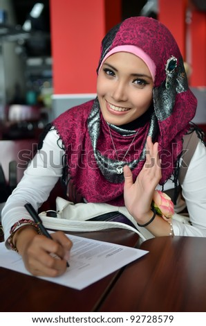 Lovely of young Asian businesswoman working and smile