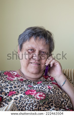 lovely old woman on phone - stock photo