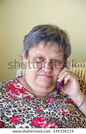 lovely old woman with cellphone - stock photo