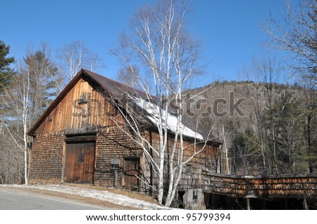 Lovely old wooden barn at the side of the road near Newry, Maine - stock photo
