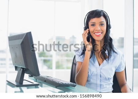 Lovely operator posing and looking at camera in office - stock photo