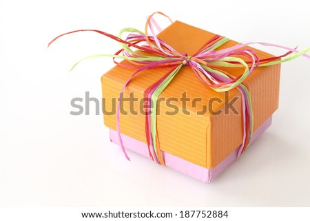 Lovely orange and pink present (gift box) with ribbons - stock photo