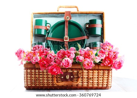 lovely picnic basket with pink tulips - food and drink - stock photo