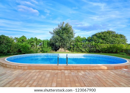 Lovely pool in the garden in the park. - stock photo