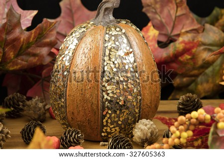 Lovely Pumpkin and Candle table decorations with plated chocolates for sharing