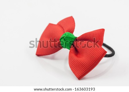 Lovely red hairpin isolated on white background