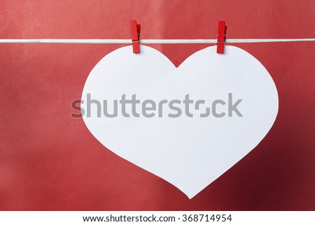 lovely red hearts - big white Heart hanging on the clothesline. Space for info text. On old color background. Romantic date, love Valentines Day concept. Toned image - stock photo