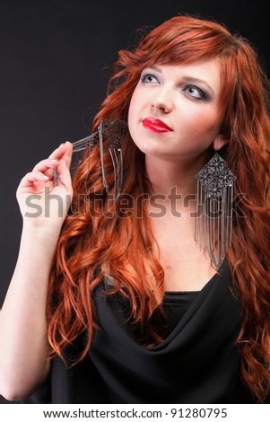 lovely redhead - Young beautiful red haired woman blue eye - stock photo