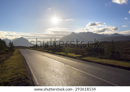 lovely road to the mountains in scotland on the isle of skye - stock photo
