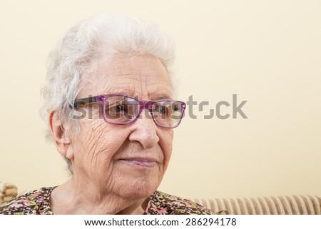 lovely senior woman wearing eyeglasses - stock photo
