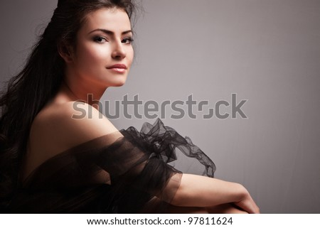 lovely sensual young woman portrait small amount of grain added - stock photo
