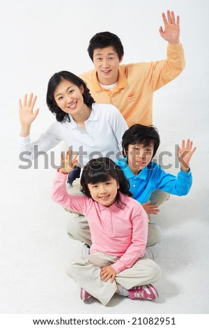 Lovely Smiling Family - raising hands in greeting or hand signs