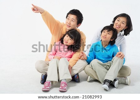Lovely Smiling Family with hand sign