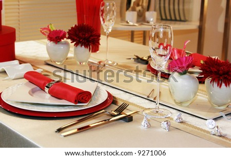 Lovely table setting for two in red - stock photo