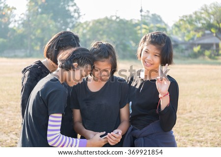 lovely  teenage girl use phone   - stock photo