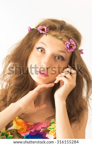 lovely teenage girl with floral dress posing