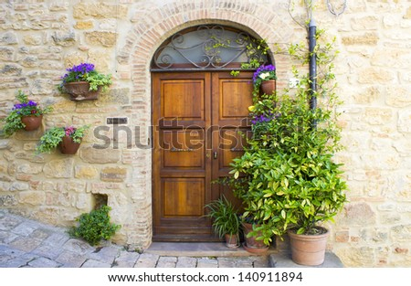 lovely tuscan doors, Volterra, Italy - stock photo