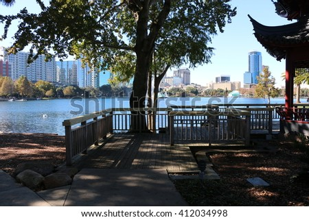 Lovely view of the lake in the Eola park/Lake and tree/Please visit my portfolio for more photos like this! - stock photo