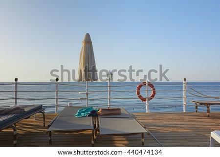 Lovely view of the sea from the promenade. Beach season marine recreation - stock photo