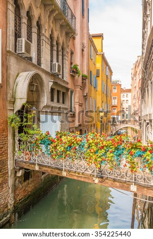 Lovely view on the bridge and the canal of Venice.