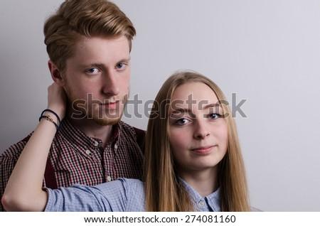 lovely white caucasian couple in love studio indoor portrait  - stock photo