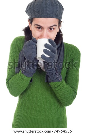 lovely winter woman drinking hot coffee/tea (isolated on white background)
