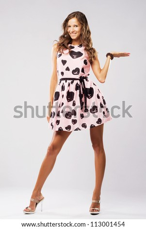 Lovely woman holding something imaginary - stock photo