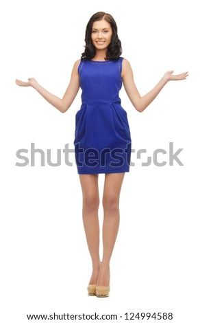 lovely woman in dress showing something on the palms of her hands - stock photo