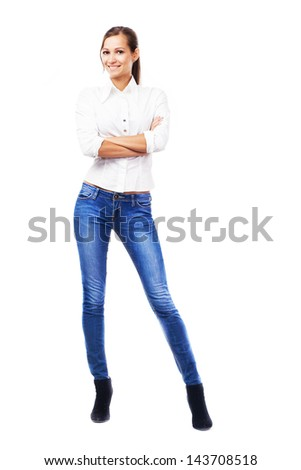 Lovely woman in white shirt and blue jeans, isolated on white background - stock photo