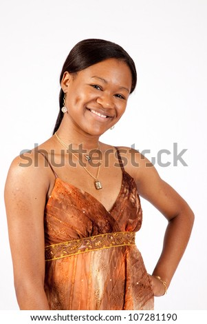 Lovely woman of color smiling with joy at the camera
