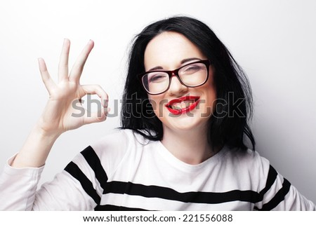 lovely woman showing victory or peace sign  - stock photo