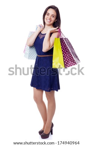 Lovely woman standing with shopping bags, isolated on white