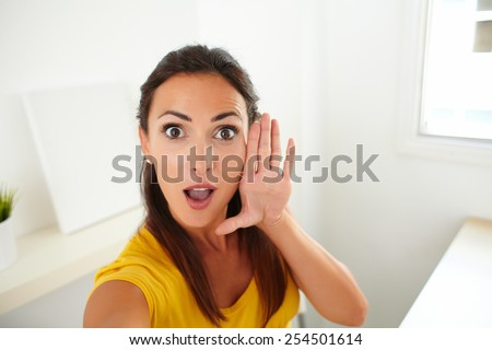 Lovely woman taking a funny selfie portrait using her cellphone - stock photo