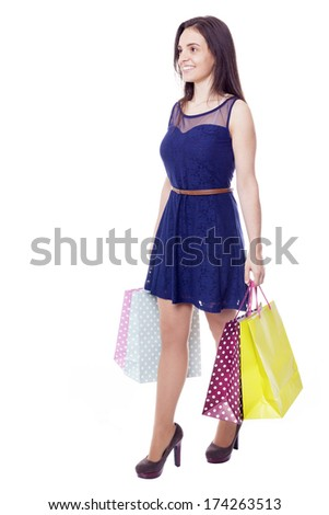 Lovely woman walking with shopping bags, isolated on white