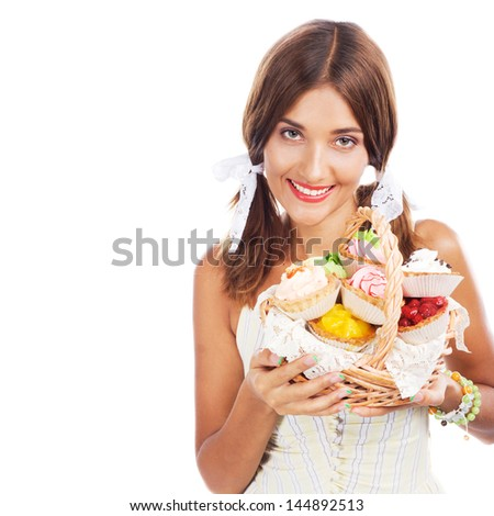 Lovely woman with a basket of cakes against white background