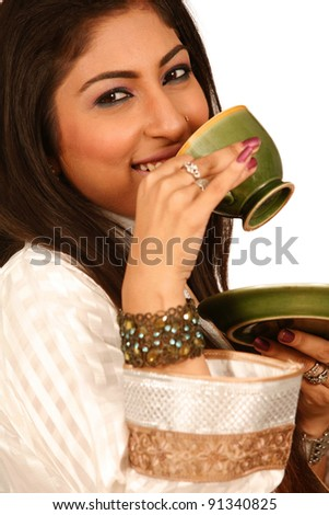 Lovely woman with a cup of green tea