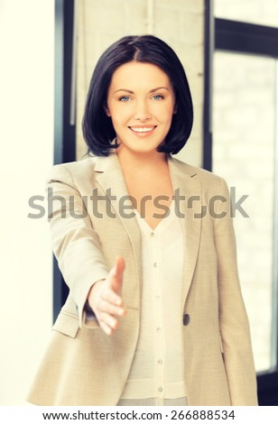lovely woman with an open hand ready for handshake - stock photo