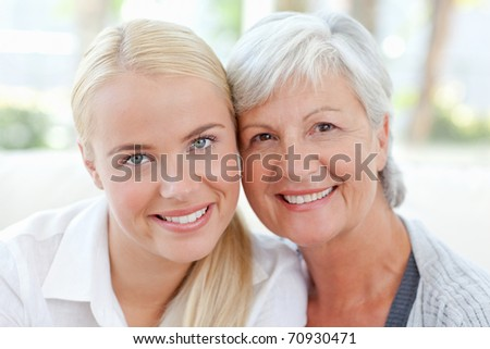 Lovely woman with her mother at home - stock photo