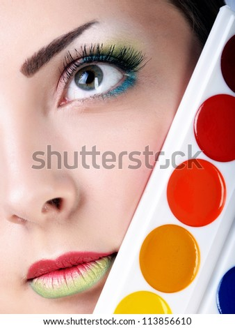 lovely woman with palette - stock photo