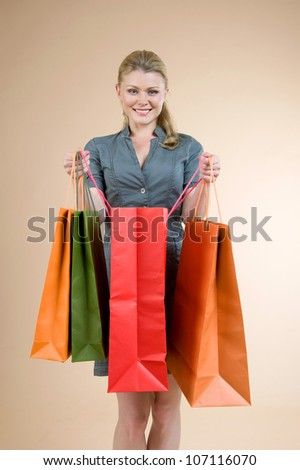 lovely woman with shopping bags - stock photo