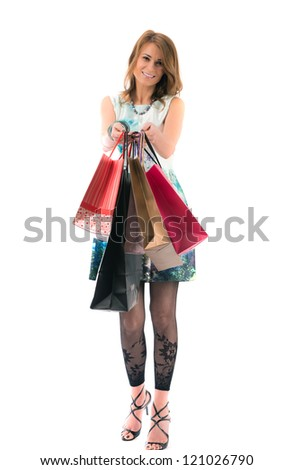 lovely Woman with shopping bags on white background - stock photo