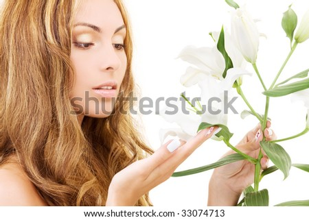 lovely woman with white madonna lily flower