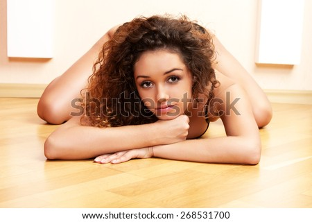 Lovely women in lingerie on wood floor.  - stock photo